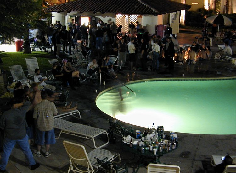 A typical scene at Defcon. This was taken in 2000 when the event was at  the beloved Alexis Park Resort where drinking poolside was a main attraction.