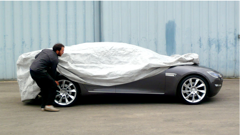 A peek at the Model S sedan. The all-electric car will have 440-volt fast charging battery capability.