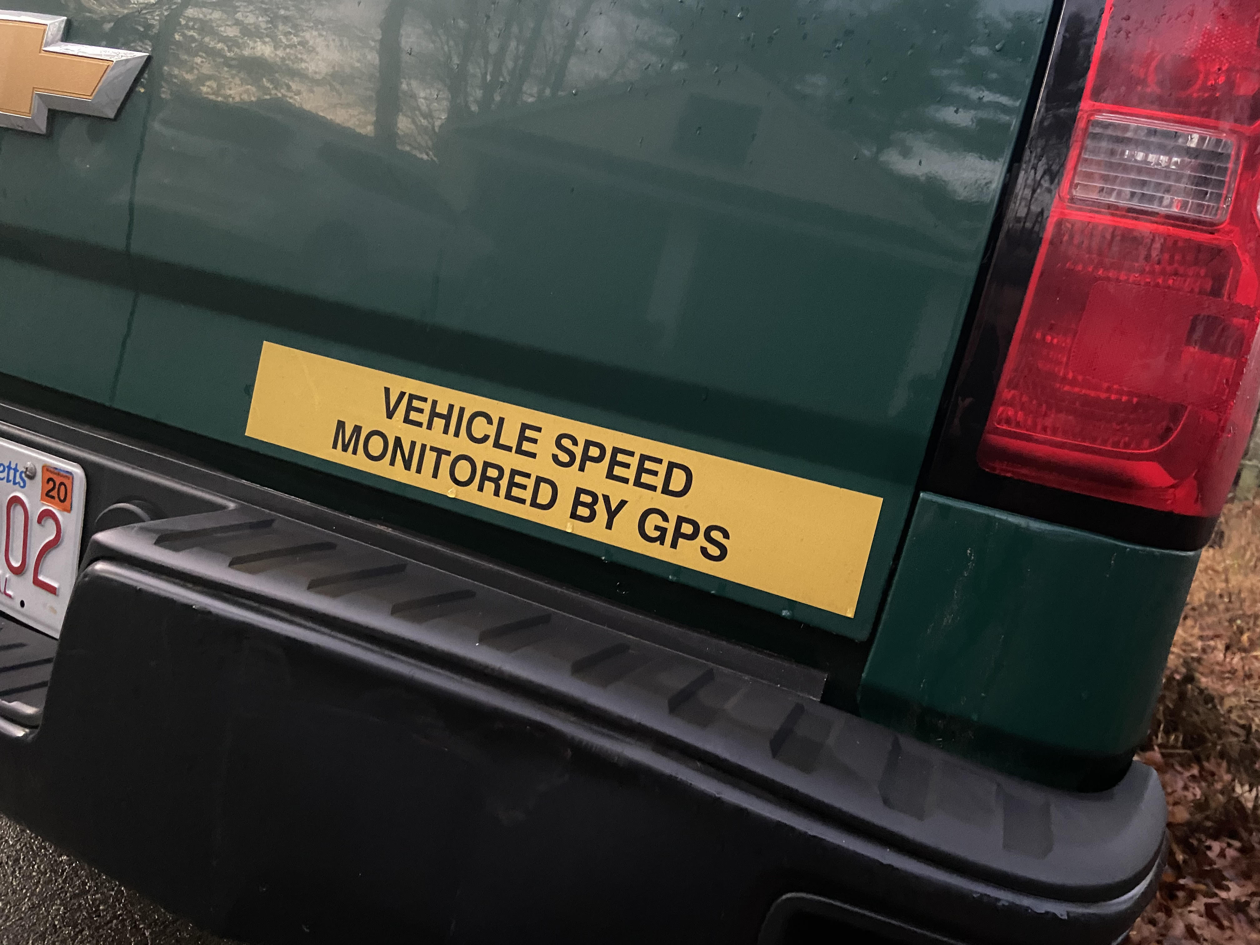"""Bumper sticker on a truck reading """"Vehicle speed monitored by GPS"""""""