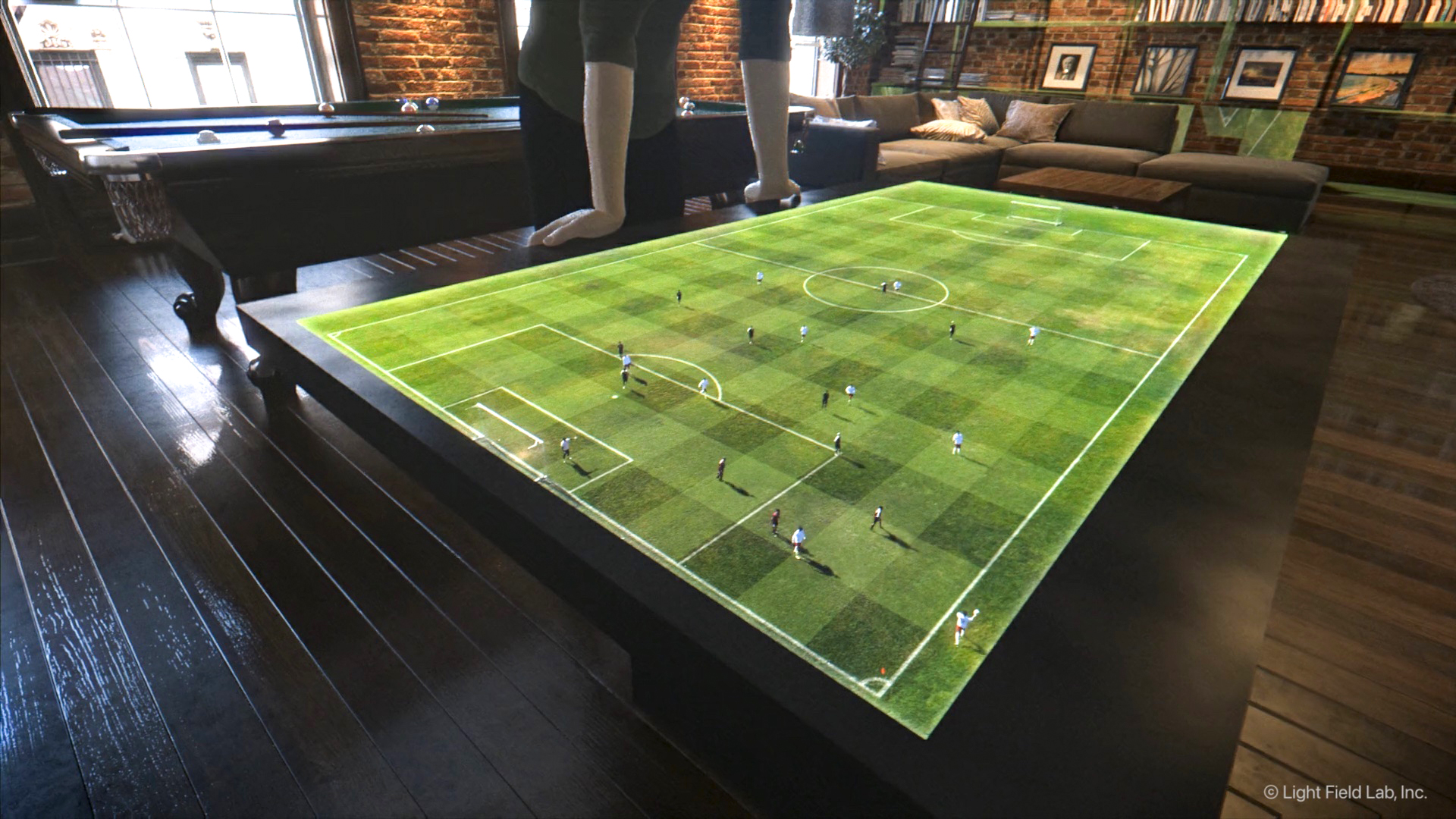 Future vision art of SolidLight Display showing a holographic soccer pitch