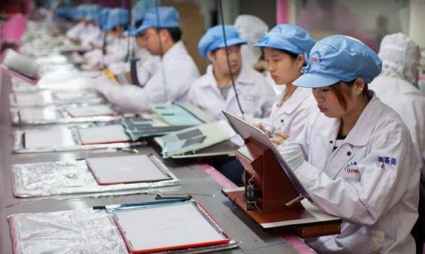 Foxconn workers assembling Apple products.