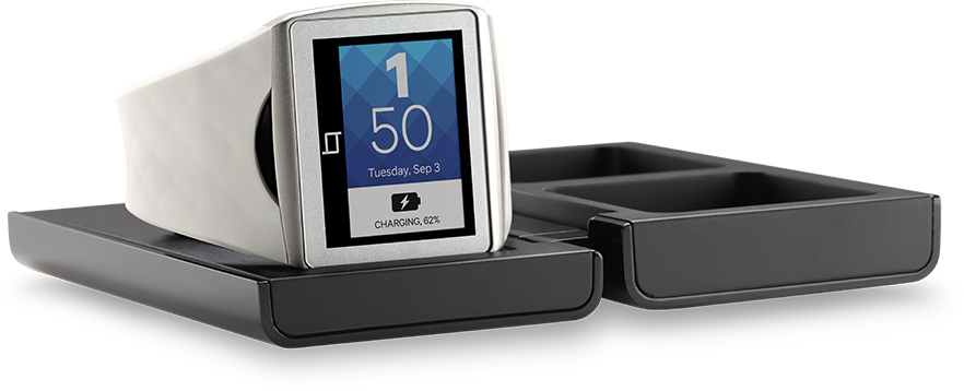 The Qualcomm Toq on its wireless charger.
