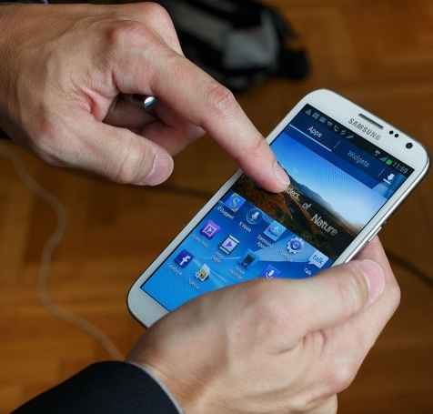 A rumored 5.7-inch Apple device would take on the 5.5-inch Samsung Galaxy Note.