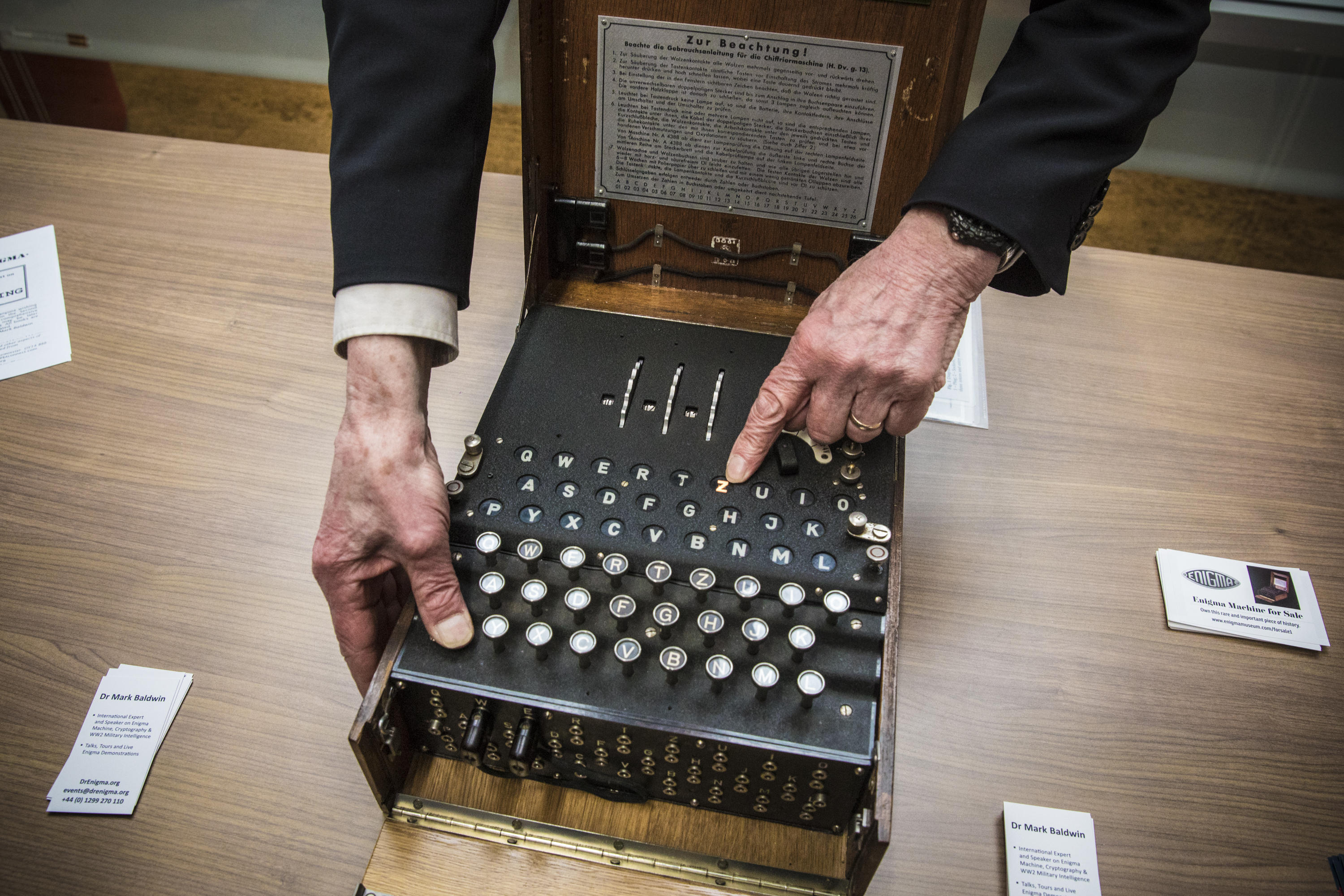 """Mark Baldwin demonstrates the Enigma cipher machine, which he says """"just changes one letter into another."""" The way it does that is much more complicated than you might imagine."""