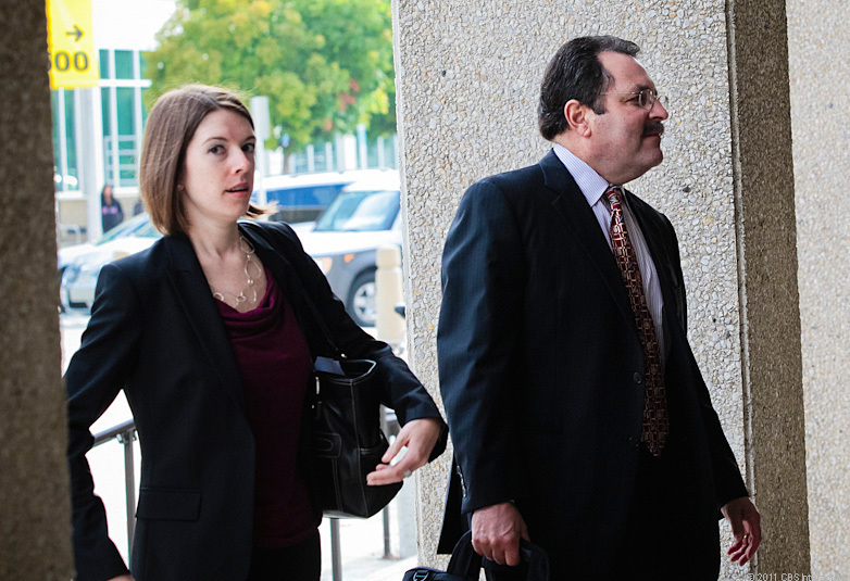 Claudia Quiroz and Jeff Bornstein, attorneys for a man facing criminal charges relating to an iPhone prototype, enter a San Mateo county courthouse today.