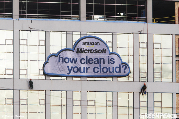 Greenpeace makes a splash in Seattle by hanging this sign off a building near Microsoft and Amazon offices.
