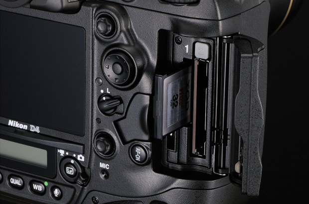 This shot shows the dual CompactFlash and XQD slots of Nikon's D4 SLR. The XQD slot toward the left is significantly smaller.
