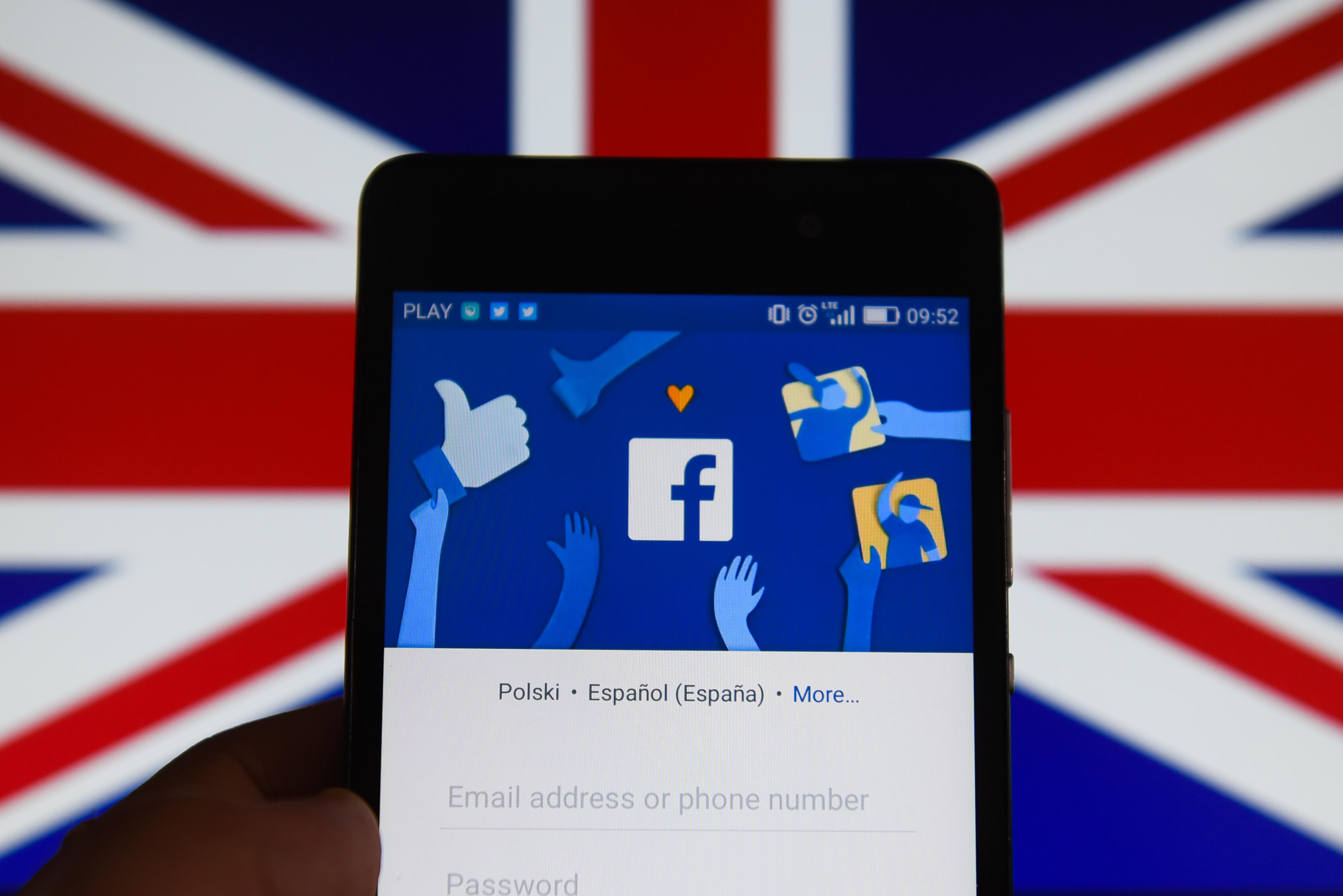 Facebook app with United Kingdom flag are seen in this photo