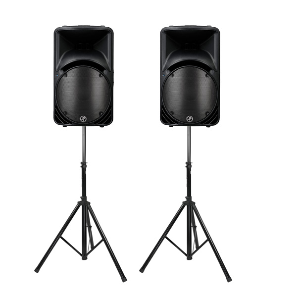 Mackie SRM PA speakers on stands.