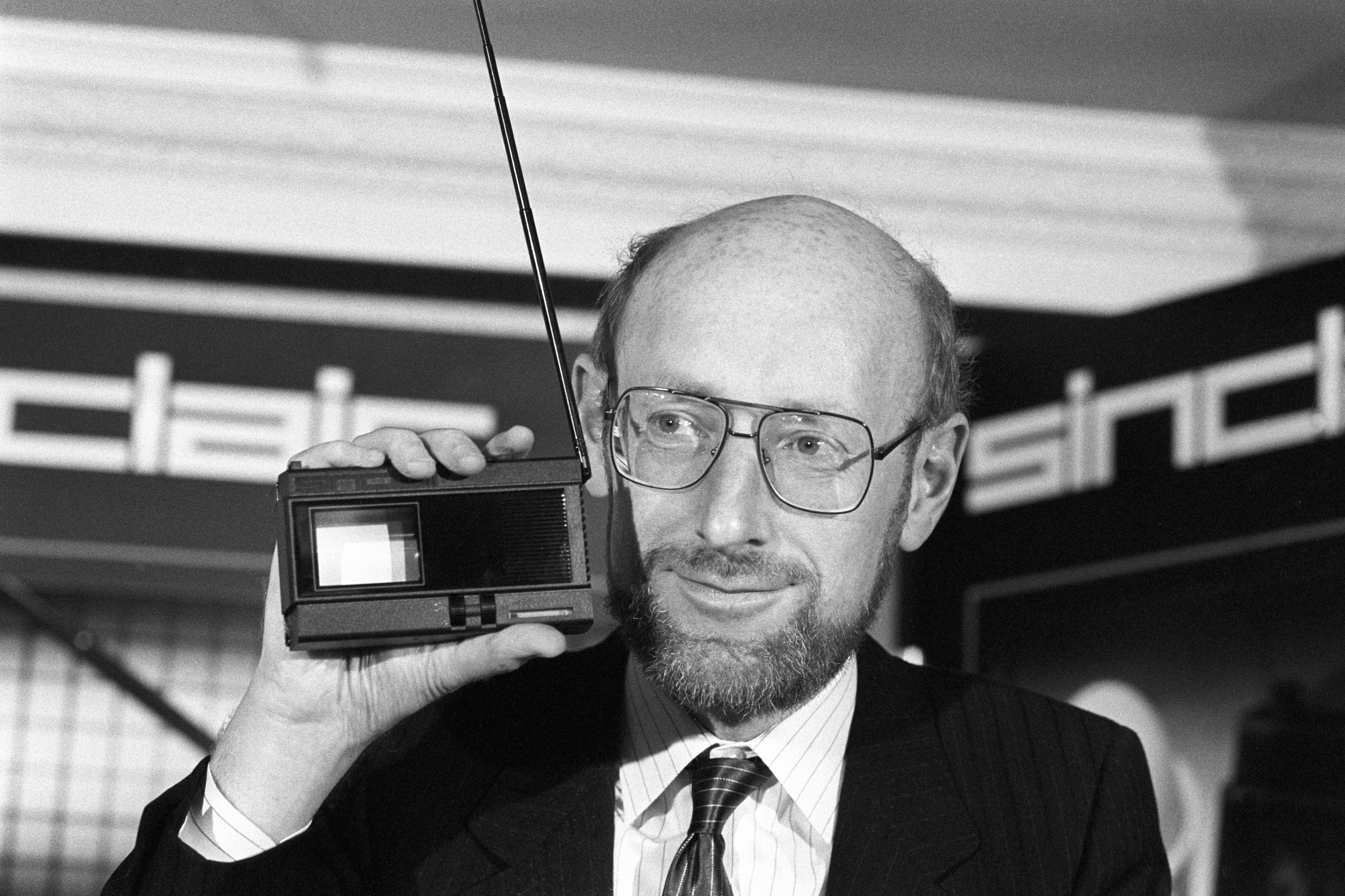 Clive Sinclair, founder and chairman of Sinclair Research, at the launch of the Sinclair 2-inch pocket television