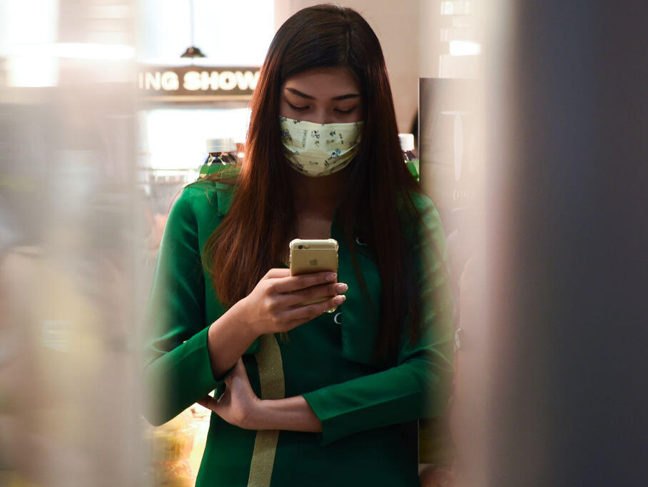 Amid the global scare over the coronavirus, a woman wears a mask at an airport in Thailand.