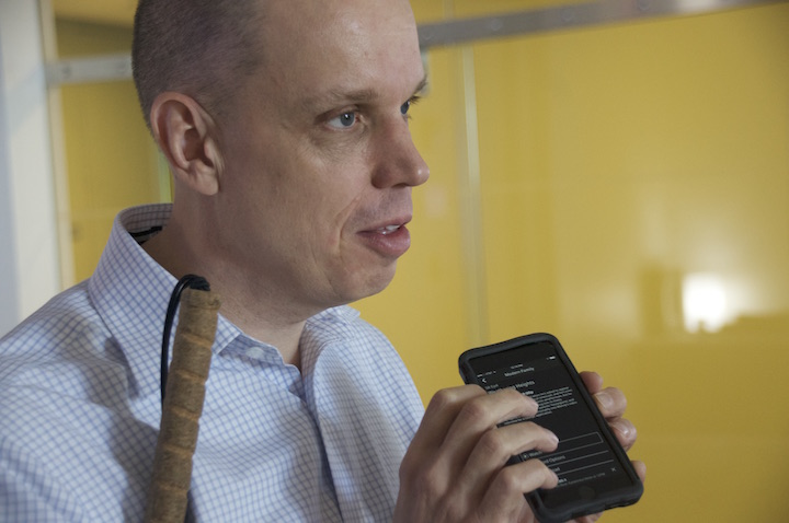 Tom Wlodkowski, who joined Comcast as its first vice president of accessibility in 2012, navigates the company's streaming app on his iPhone.