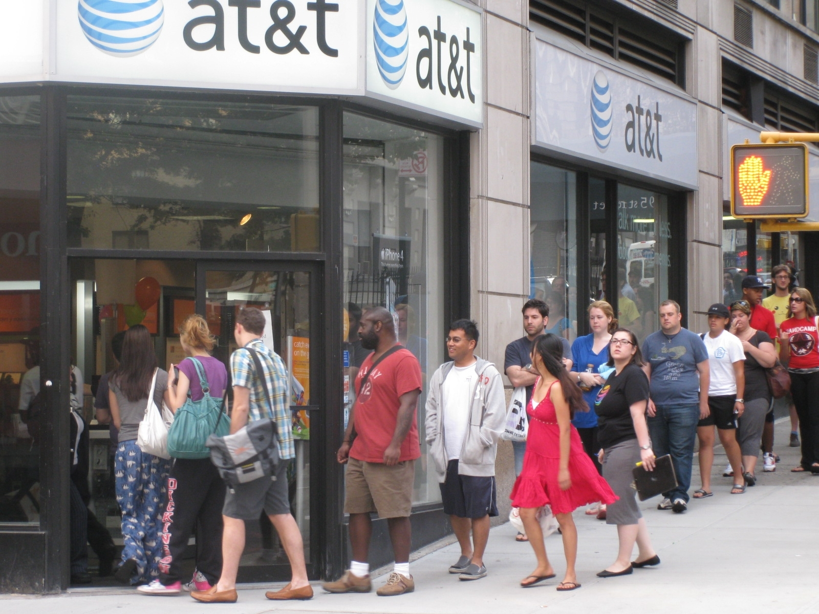 Dozens of people lined up early Tuesday morning in front of this AT&T store to get the new iPhone 4. The store was sold out of the phones by 7:30 a.m., a half hour after it opened.