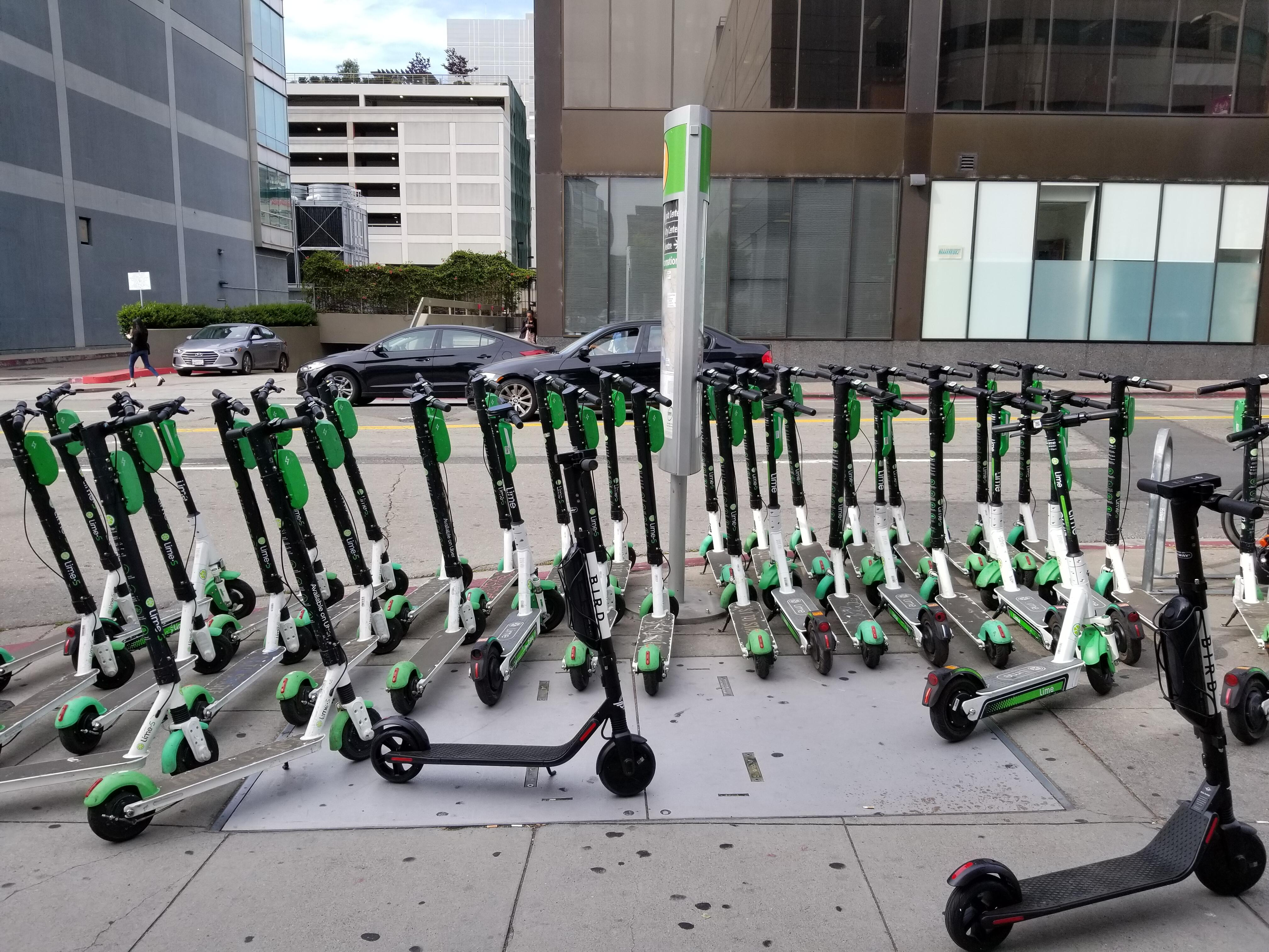 <p>Freshly charged Lime and Bird scooters.</p>