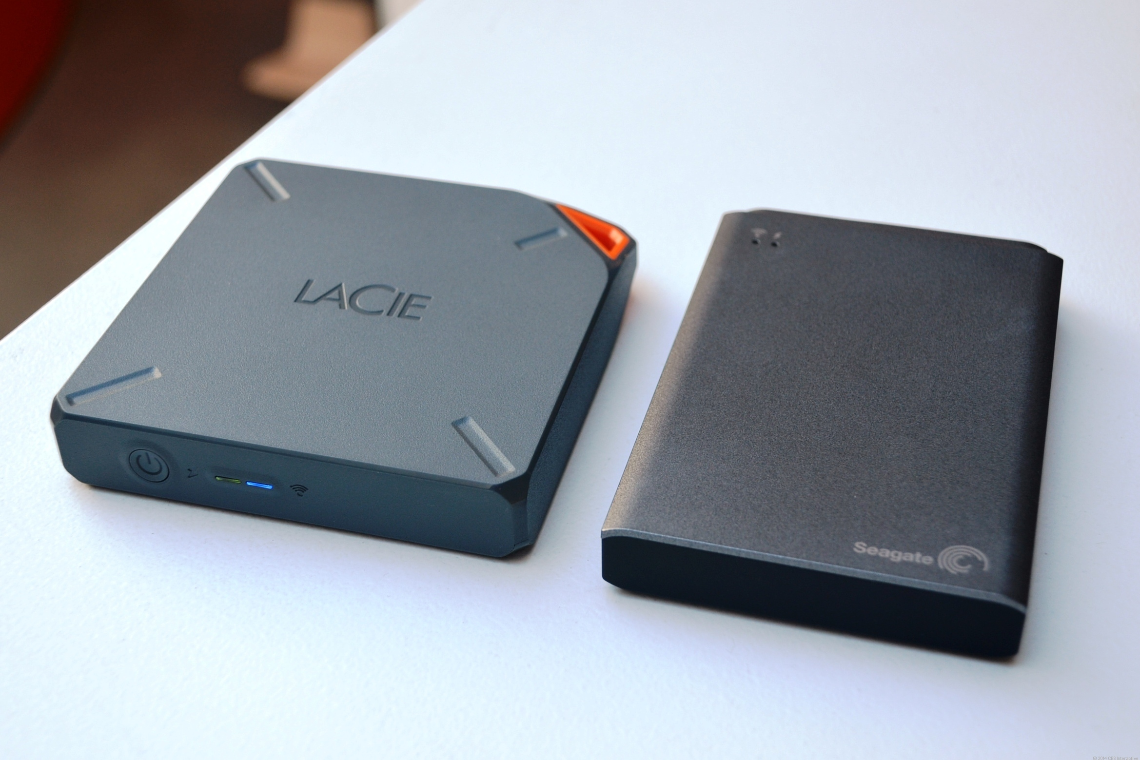 The LaCie Fuel (left) next the to Seagate Wireless Plus. The two device share the same features and mobile app.