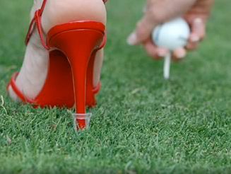 Red shoe on grass