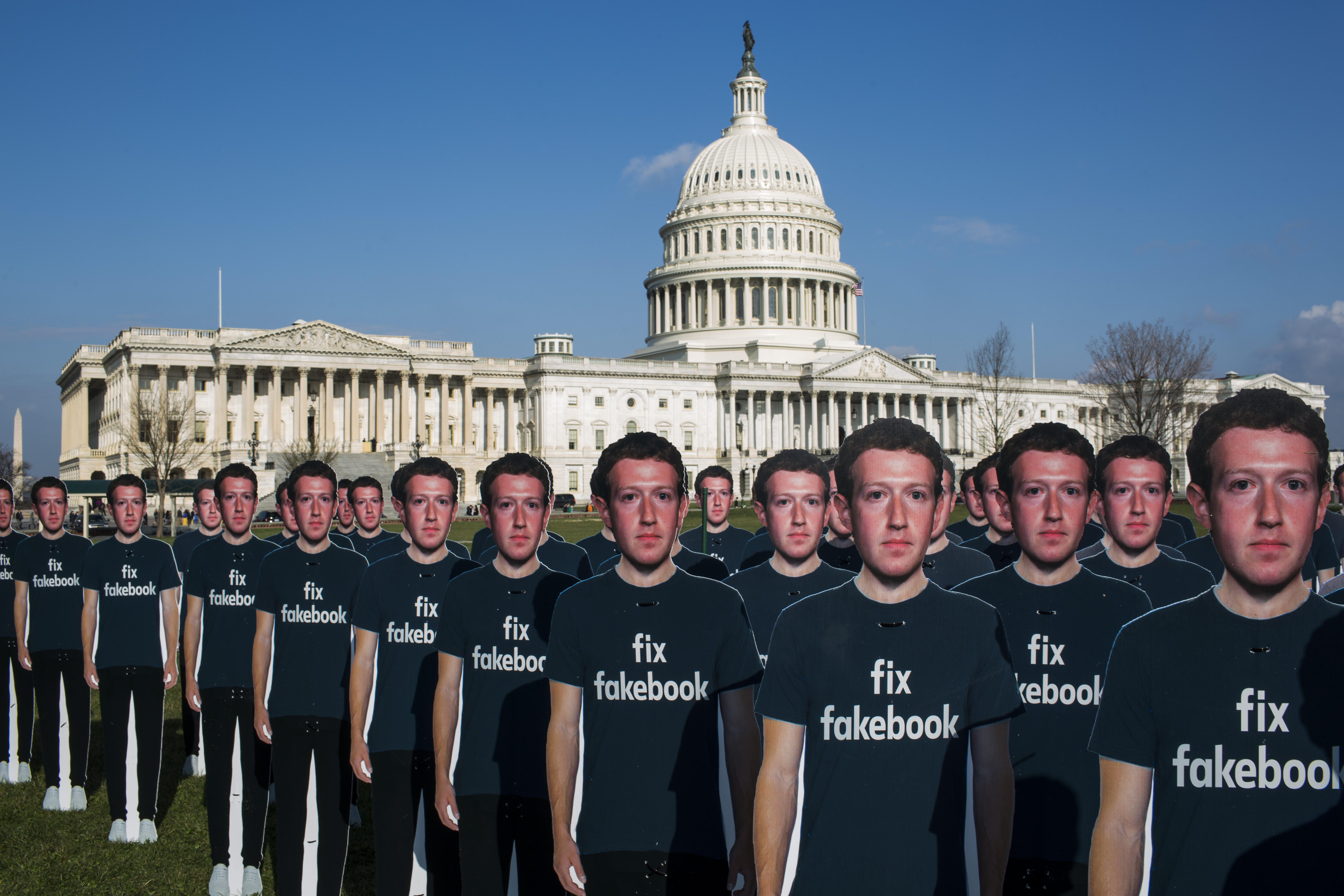 100 life-size cutouts of Facebook CEO Mark Zuckerberg on the Capitol Hill lawn.