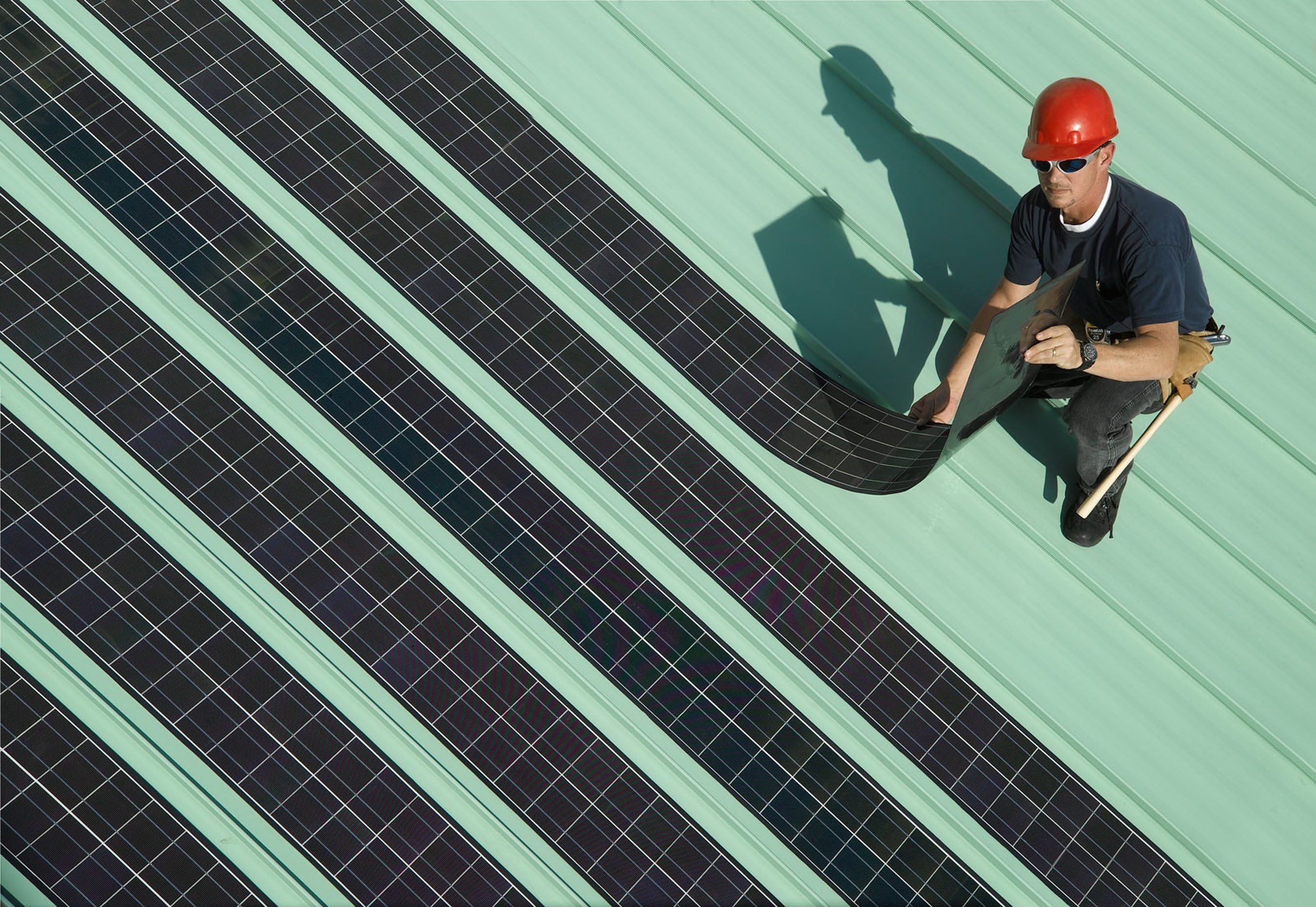 SoloPower flexible solar panels are lightweight and can be installed quickly on commercial buildings, the company says.