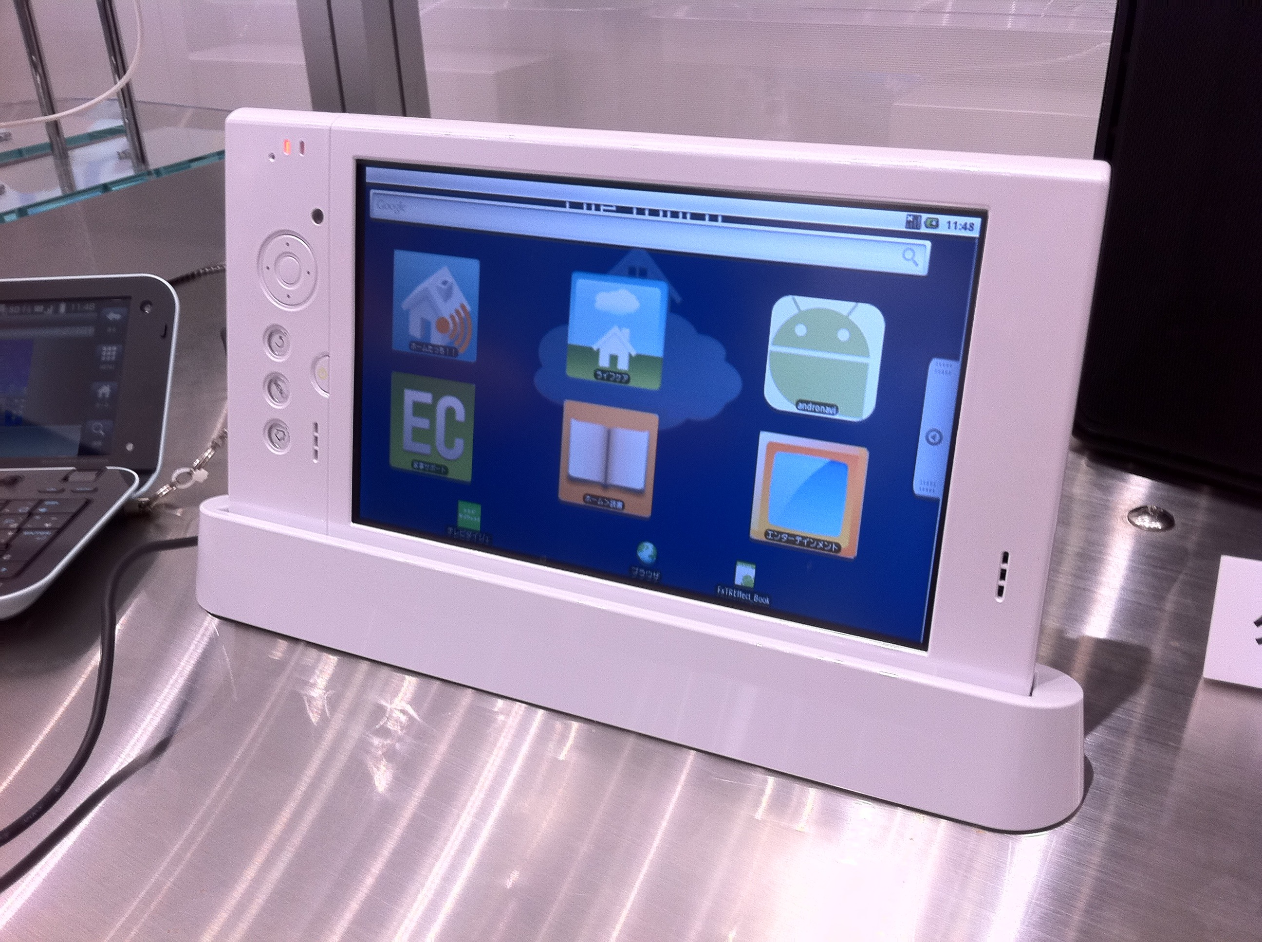 The Lifetouch tablet is running Android 2.1 with NEC's own software running on top of it. Also included: ARM processor, 7-inch touchscreen, accelerometer, docking station, SD card slot.