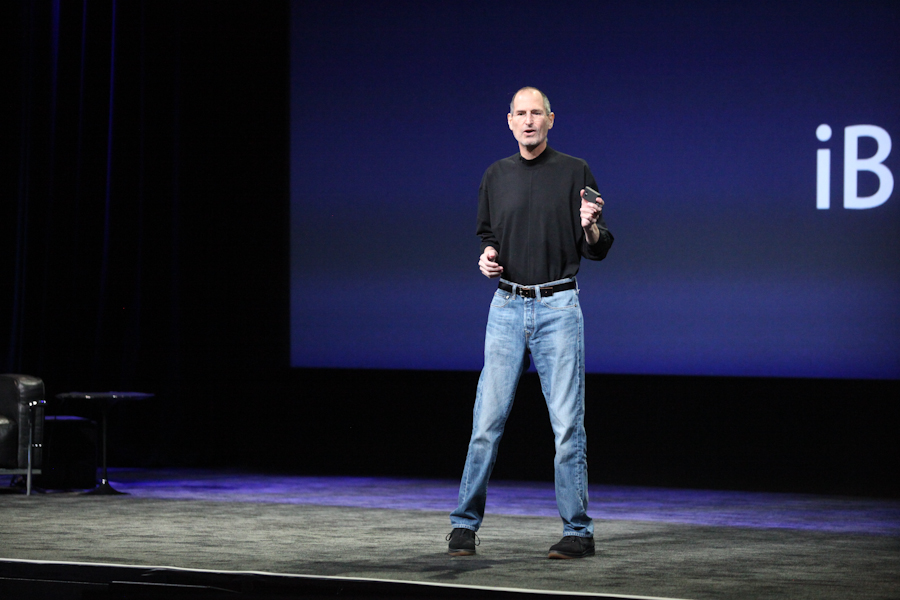 Apple CEO Steve Jobs takes the stage.