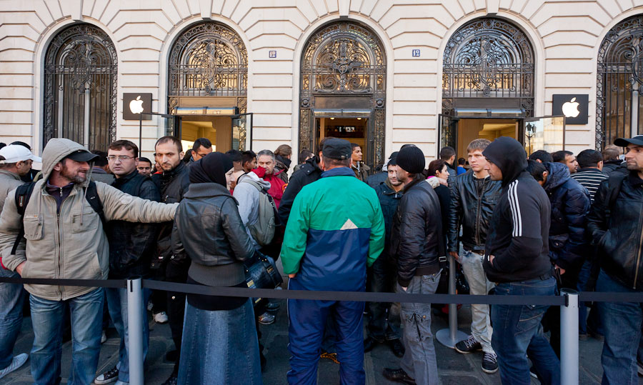 This section of the crowd waiting outside the Paris store had to get in line yesterday for their spots in the queue.