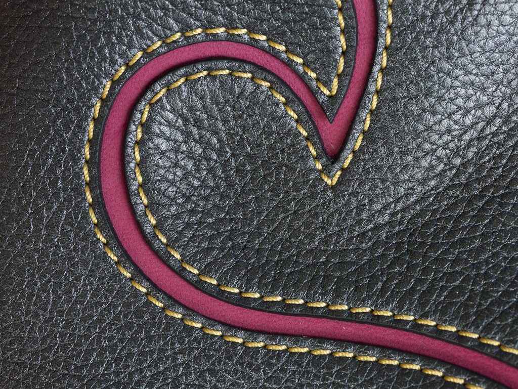 "High-end product photos, such as this close-up of a Lancel leather purse, is a key market for the <a href=""http://news.cnet.com/8301-30685_3-57335636-264/phase-one-iq180-80-megapixels-of-lavish-color/"">Phase One IQ180 digital back</a>. This was shot with"