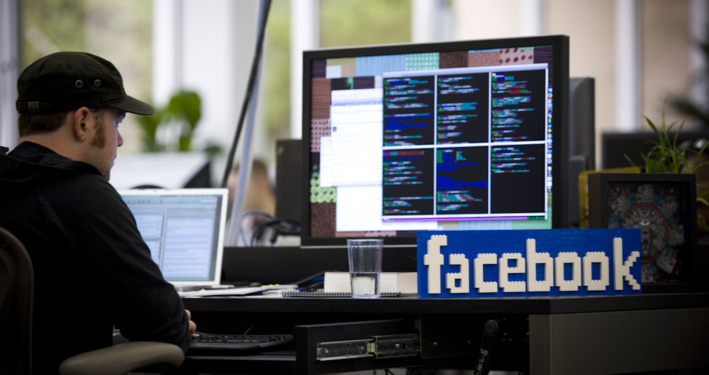 A Lego model of the Facebook logo sits on the desk of a programmer inside the company's office in Palo Alto, Calif., in June 2009.
