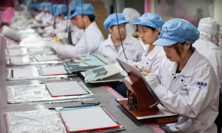 Apple supply workers assembling MacBook Pro displays in Shanghai (not the ones urging people to sign the petition).