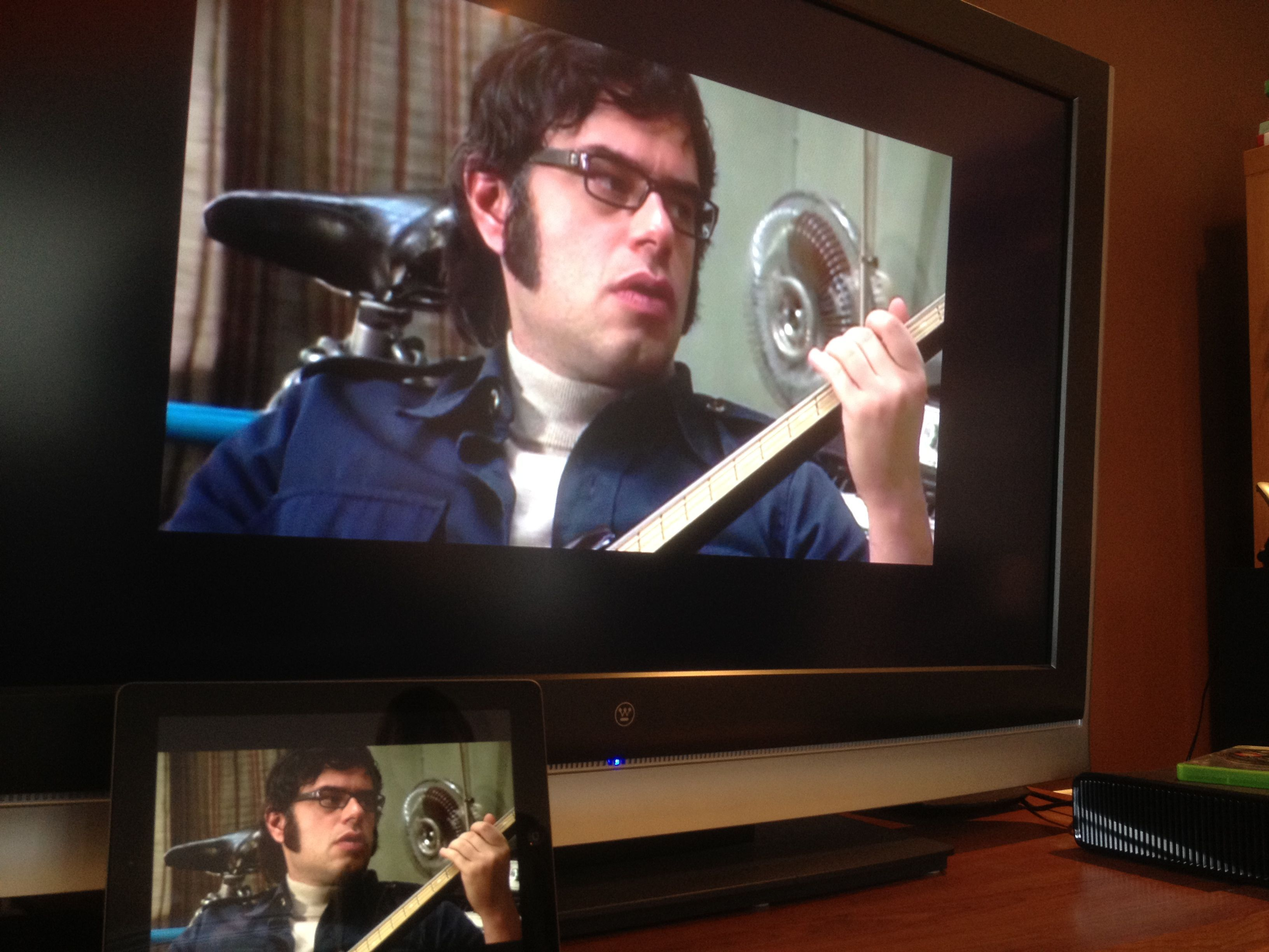 """Flight of the Conchords"" shown via a new iPad connected to an Apple TV and running the Comcast Xfinity TV app."