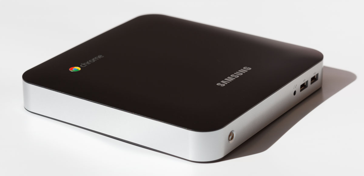 Samsung's Series 3 Chromebox has a headset-microphone jack in the front, but no built-in microphone.