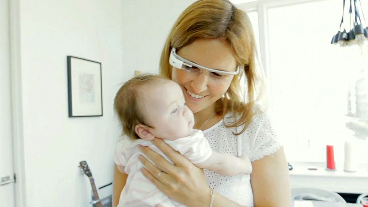 In an attempt to humanize its Project Glass, its computerized headgear, Google showed off this mother-and-child scenario. The baby will stare but not smile at an ordinary camera, but with Project Glass, a mother can both interact with the baby and record