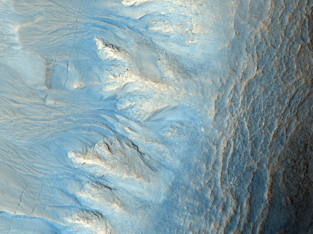 Northern Hemisphere gullies on west-facing crater slope