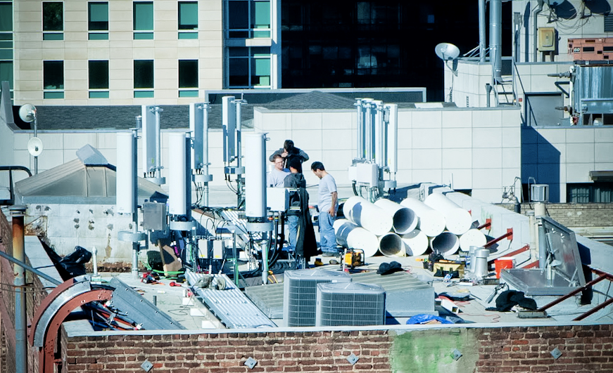 Cell towers from an unknown service provider being installed on the roof of a building in downtown San Francisco.