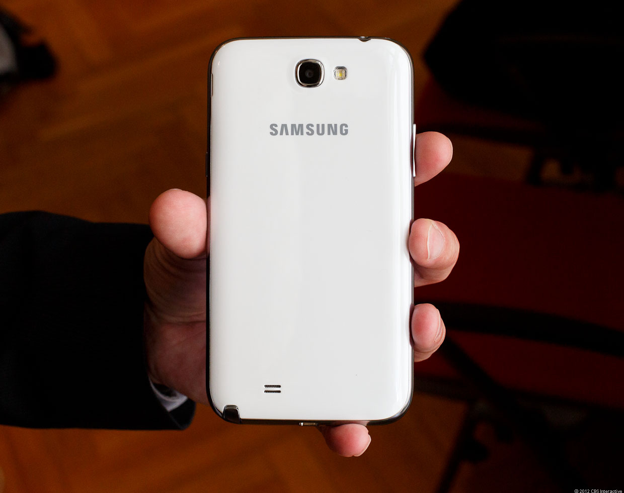 The back of the Galaxy Note 2 shows its 8-megapixel camera, LED flash, and speaker.