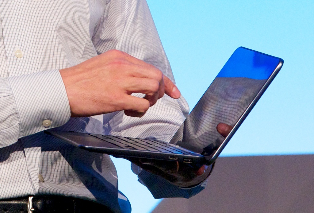Sam Burd, global vice president of Dell PC group, holds an XPS 10. Burd said the machine uses a Qualcomm processor.