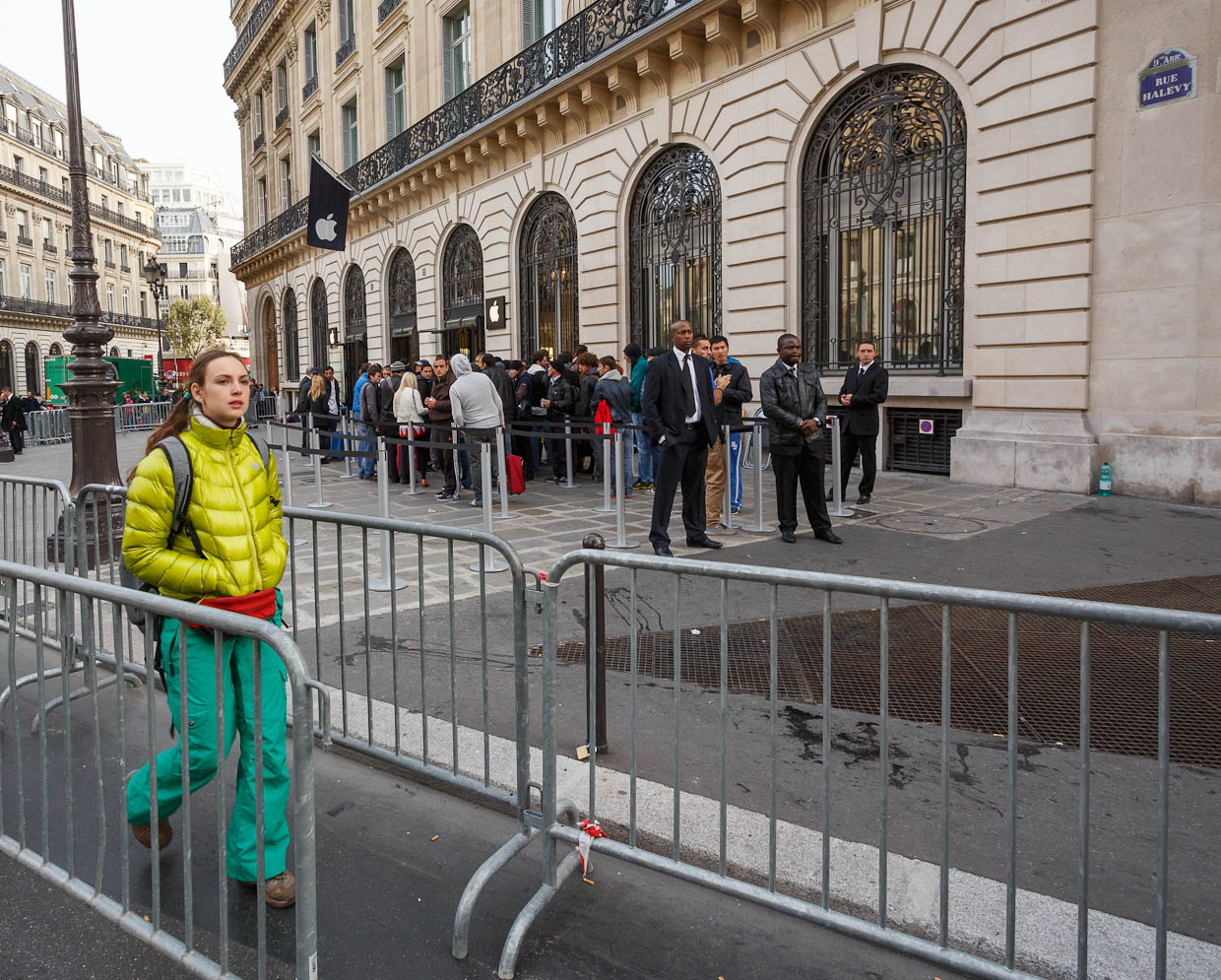 A new iPhone 5 customer emerges from an Apple store in Paris.