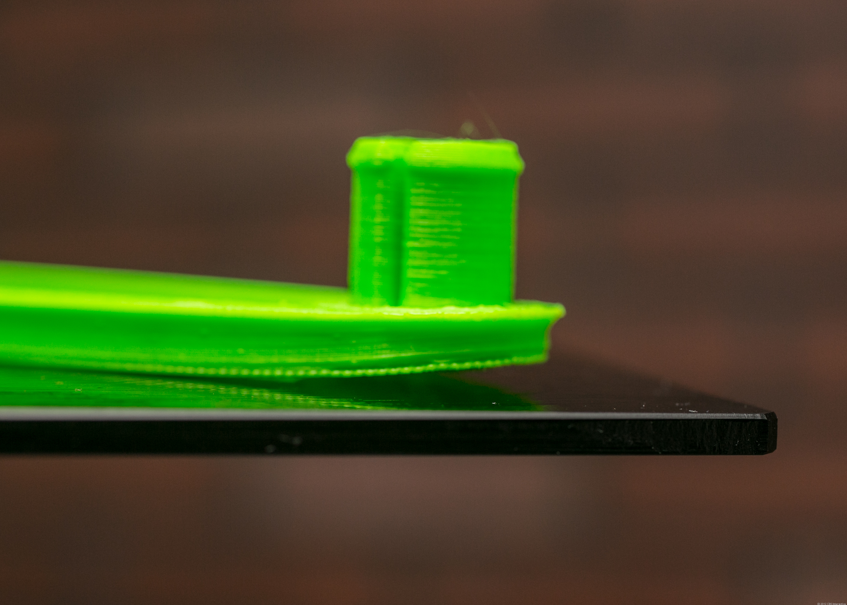 Despite the Cube's glue, ABS can still peel away from the print surface.