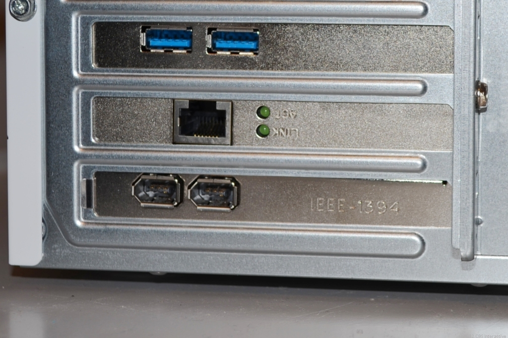Two USB 3.0 ports (note the color blue) and two FireWire 400 ports (bottom) on the back of a desktop computer.