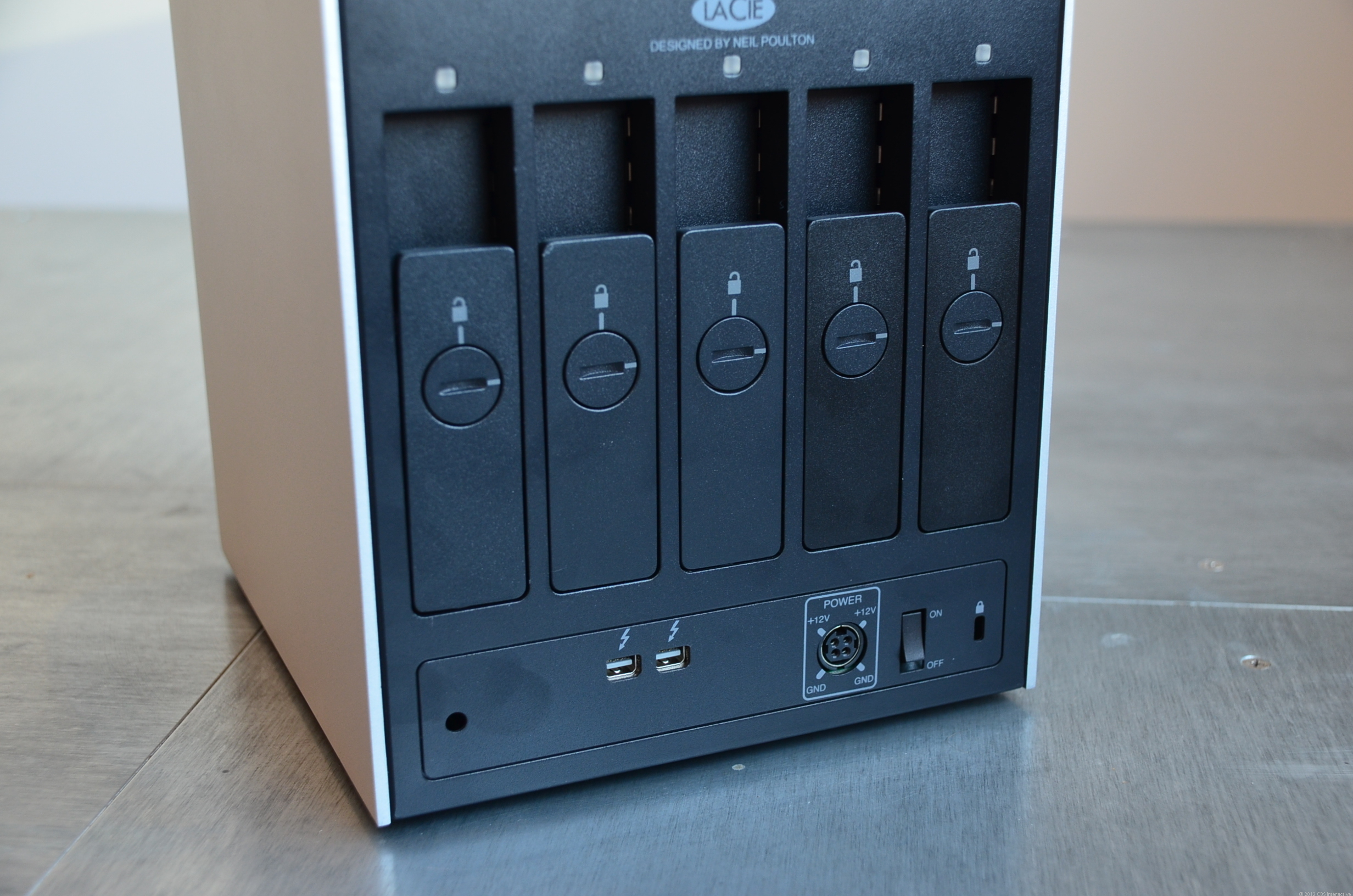 The 5big Thunderbolt drive bays are easily accessible from its back. Note the two drive bays that are darker than the other three, suggesting a dual RAID 0 and RAID 1 setup.