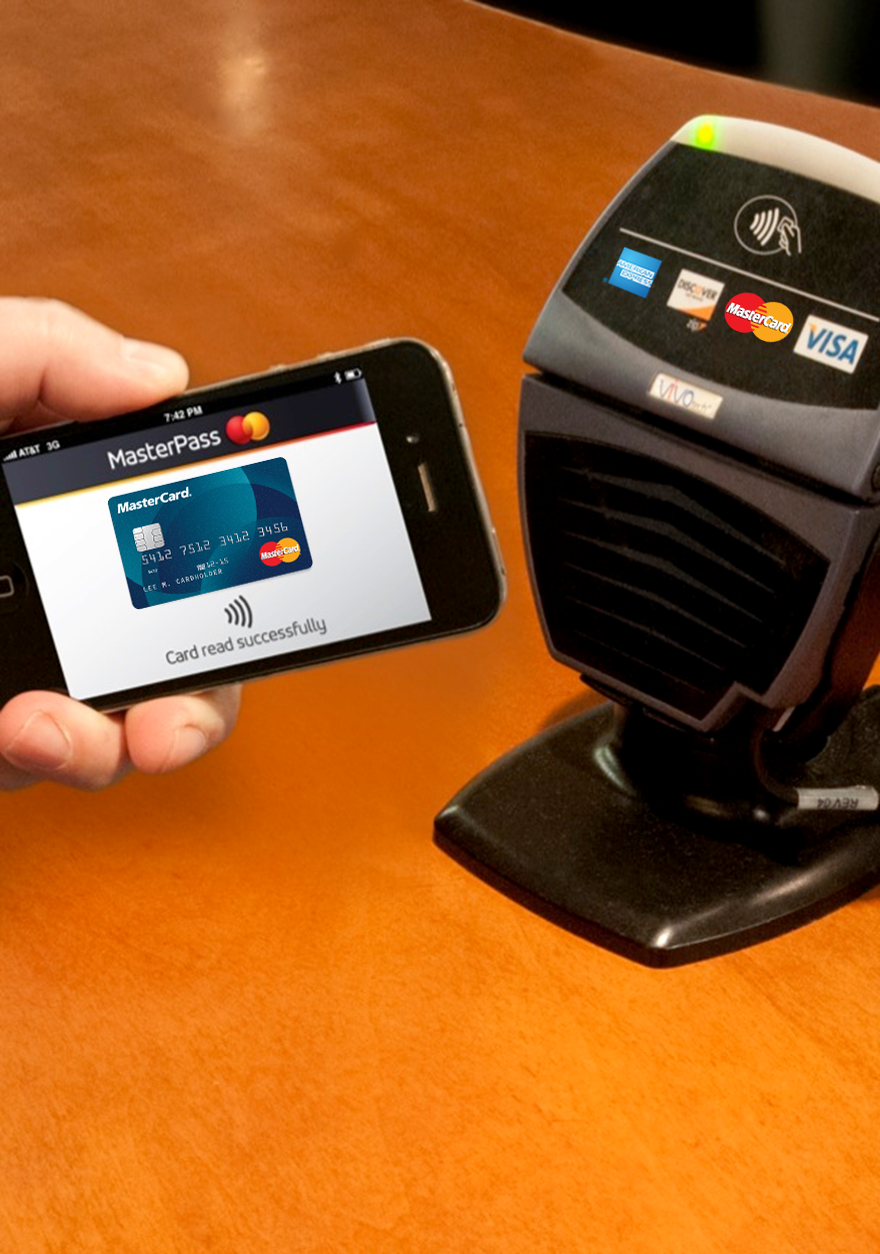 Pay for goods using MasterPass loaded on a smartphone.