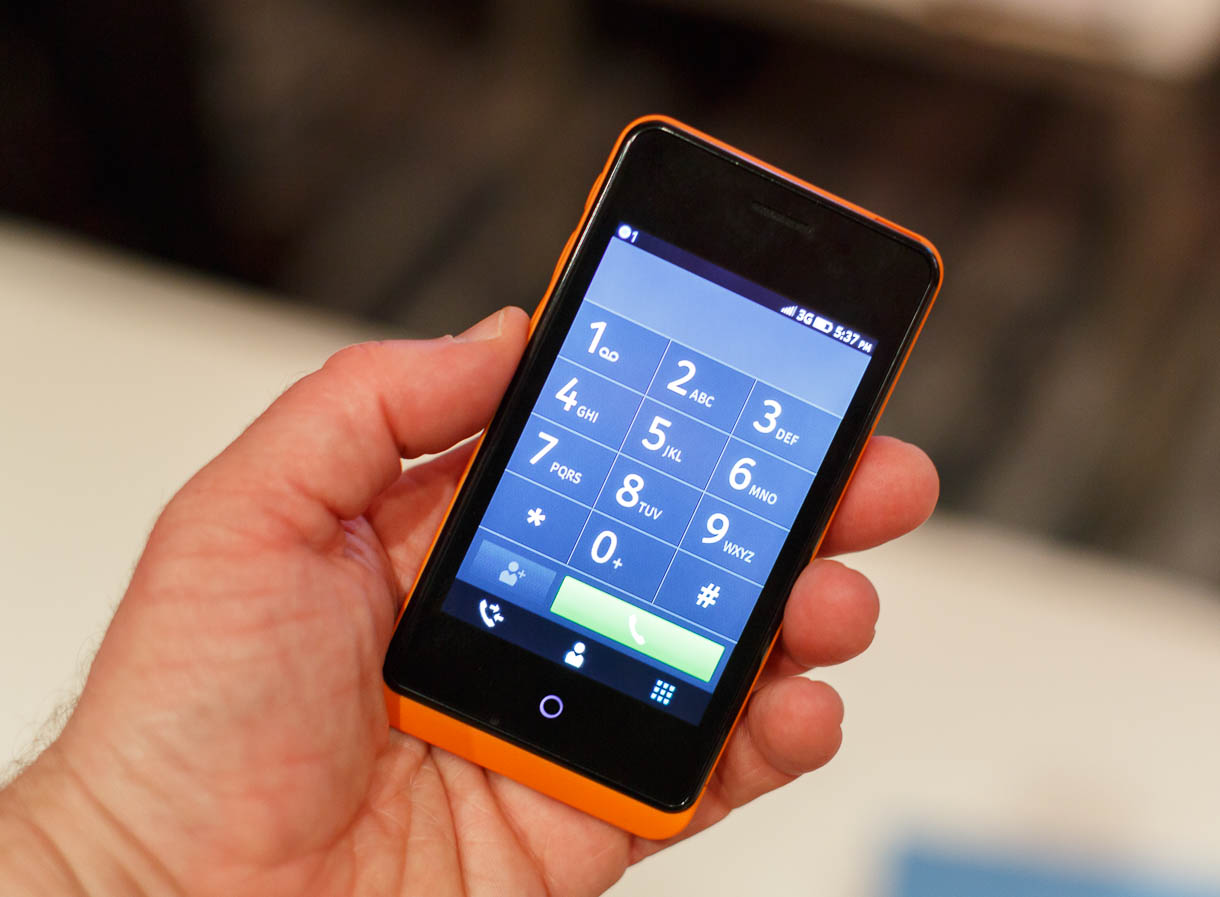 Firefox OS's phone app includes tabs for a dialing keypad, an address book to find contacts, and a recent call list.