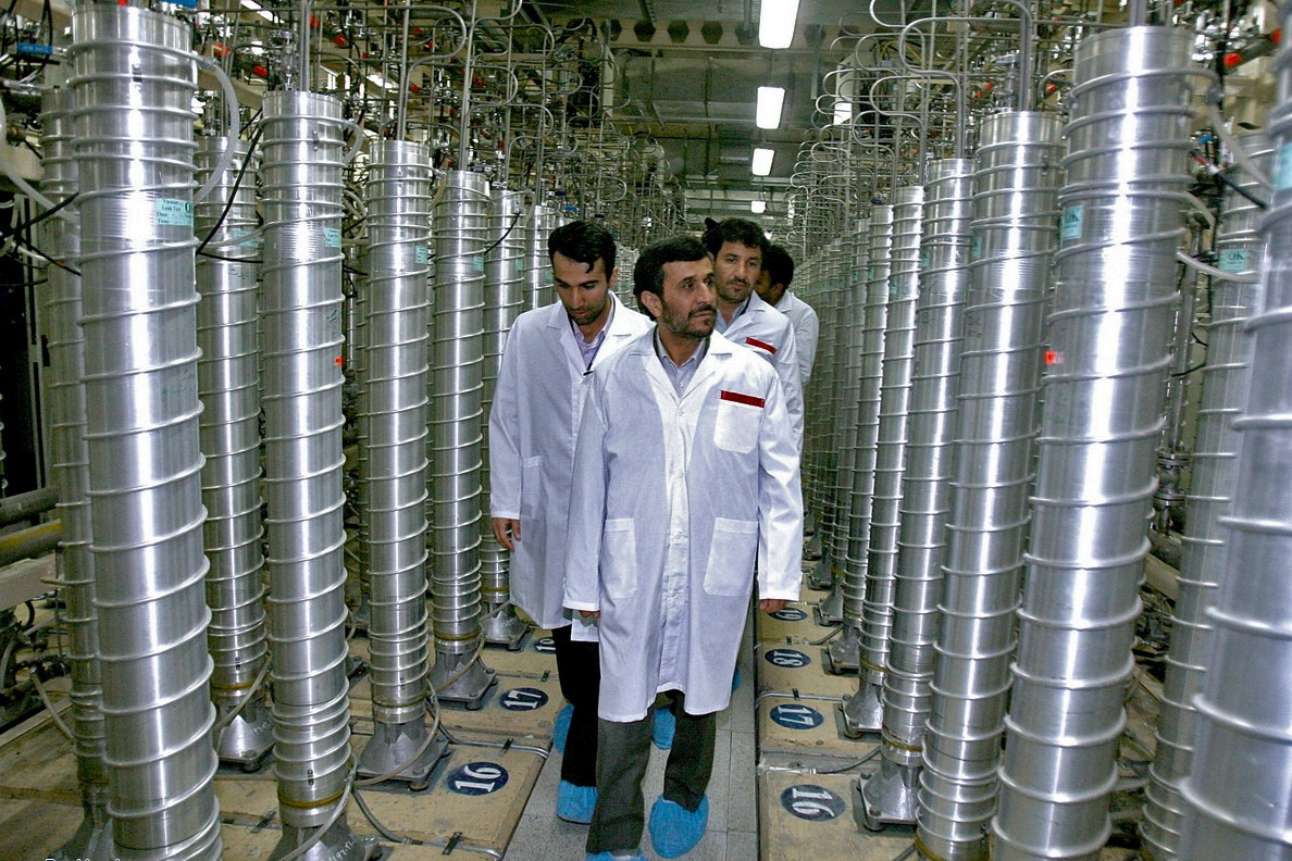 Iranian President Mahmoud Ahmadinejad (C) visits the Natanz uranium enrichment facilities.