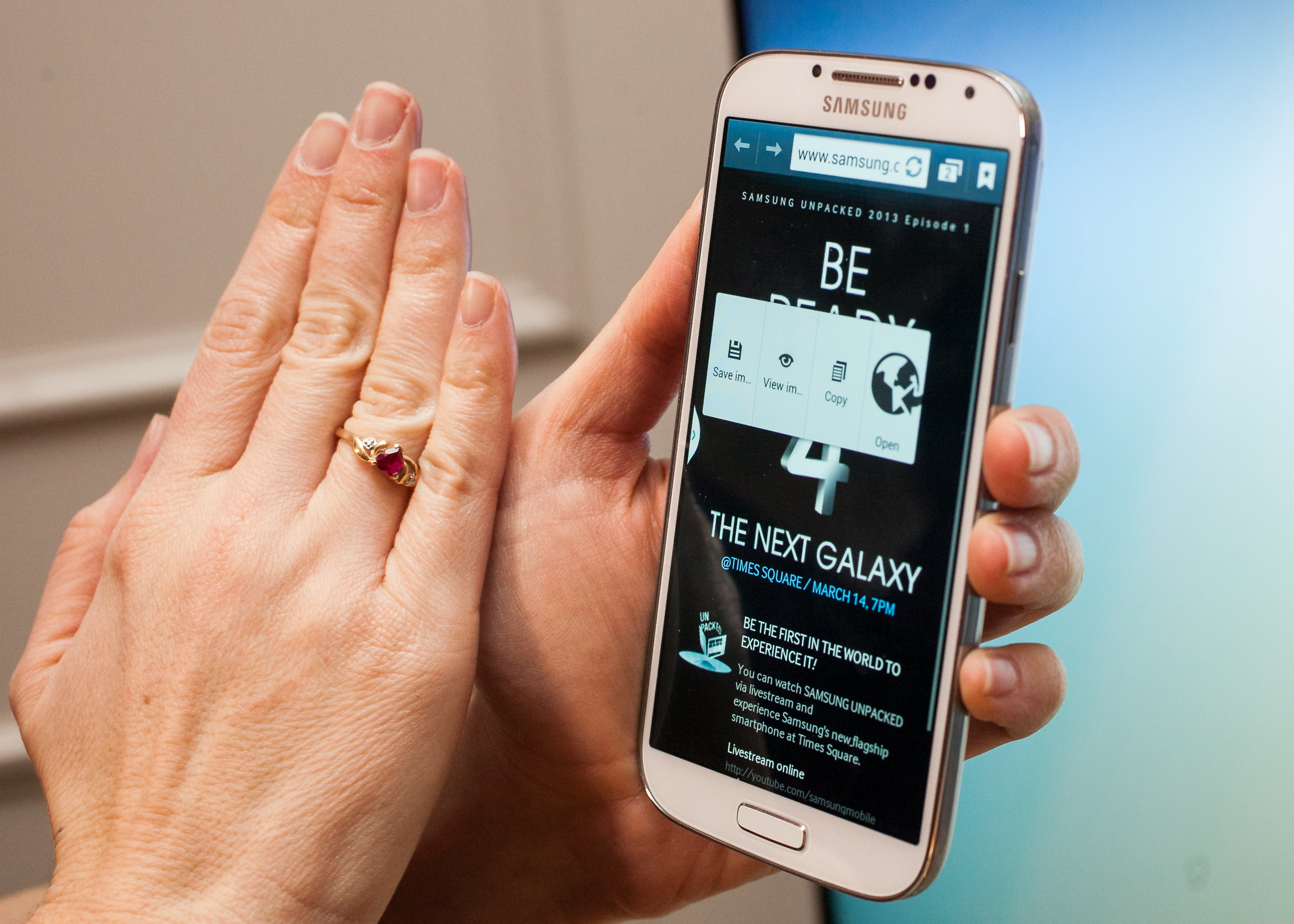 On Samsung's Galaxy S4 and others, a wave of your hand can advance your photo album, and then some.