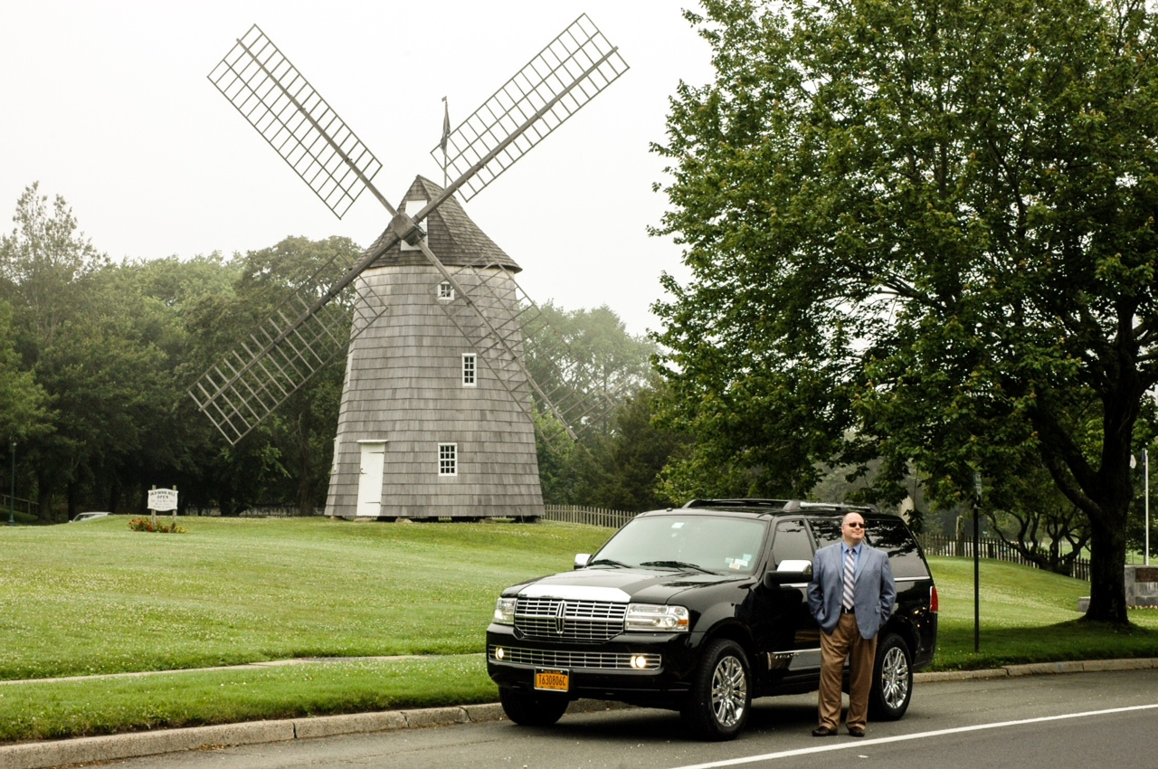 An Uber SUV sits near East Hampton's Old Hook Windmill