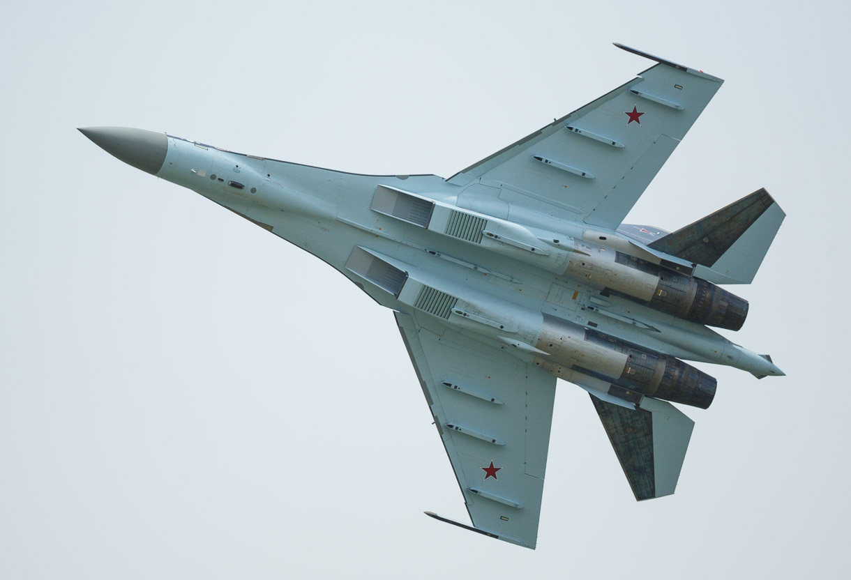 Canon EF 200-400mm f/4L IS USM Extender 1.4X is an ideal lens for air shows, where aircraft rapidly move from distant to close, where fast autofocus is necessary, and where sharp optics can capture great detail. This is a Russian jet, a Sukhoi Su-35, at t