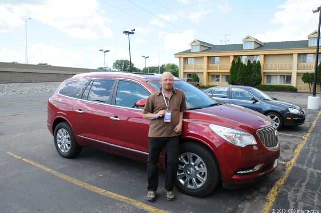CNET reporter Daniel Terdiman alongside the Buick Enclave he drove for nearly 5,200 miles during Road Trip 2013.