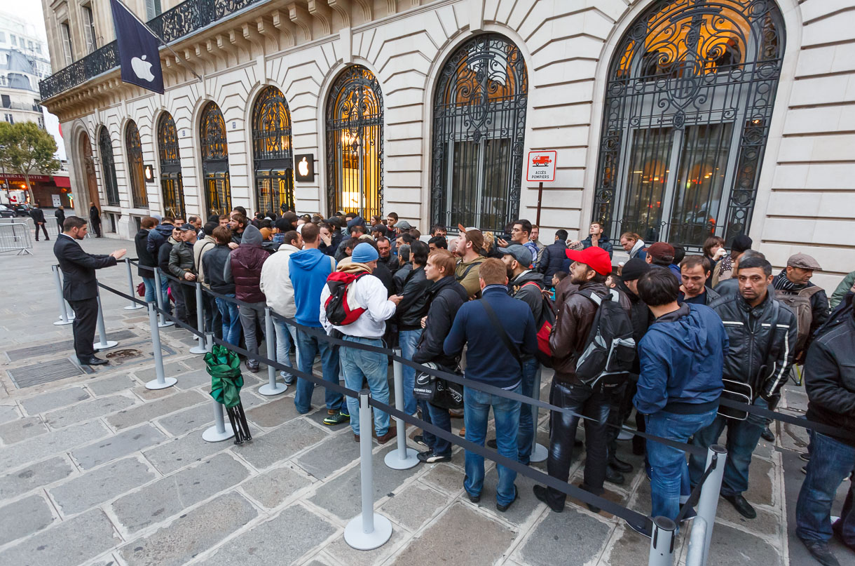 In Paris, Apple sequestered the earliest arrivals in the line to buy the iPhone 5S and 5C into a section near the Opera store. People dressed warmly for the cool but dry weather.