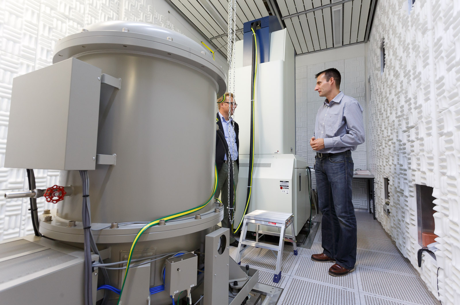 Rolf Erni, head of the Electron Microscopy Center at the Empa materials science research center, talks to a reporter next to a massive transmission electron microscope that can observe structures as detailed as individual atoms and chemical bond types.