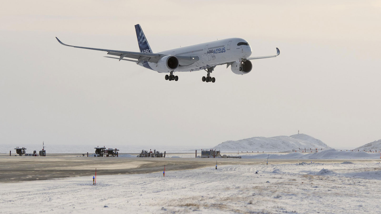 The Airbus A350 XWB flies over Iqaluit, Canada, in cold-weather testing. Another test model of the aircraft just completed hot-weather, high-elevation testing in Bolivia.