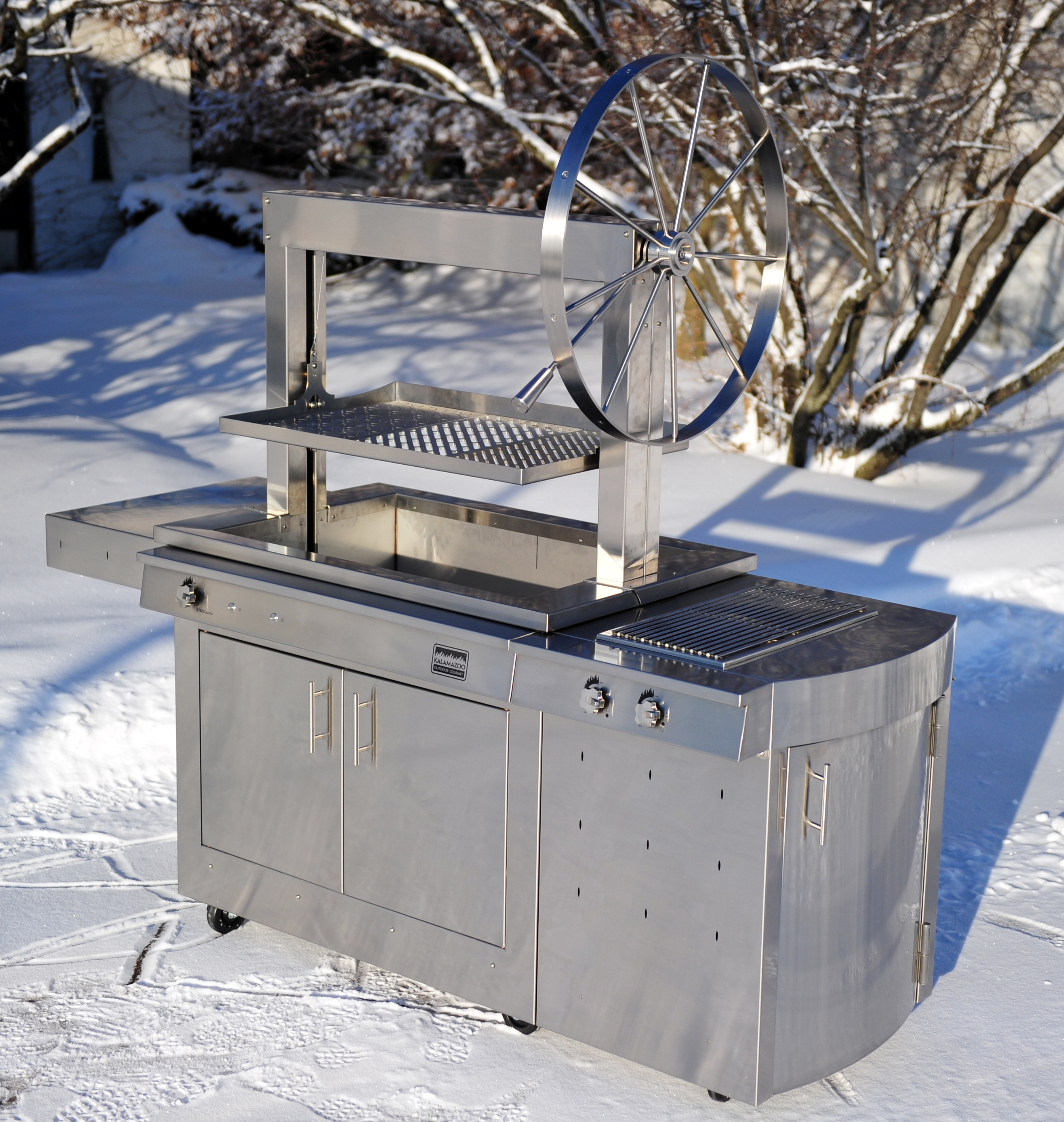 Heat up the backyard with the Kalamazoo Outdoor Gourmet Gaucho Grill.